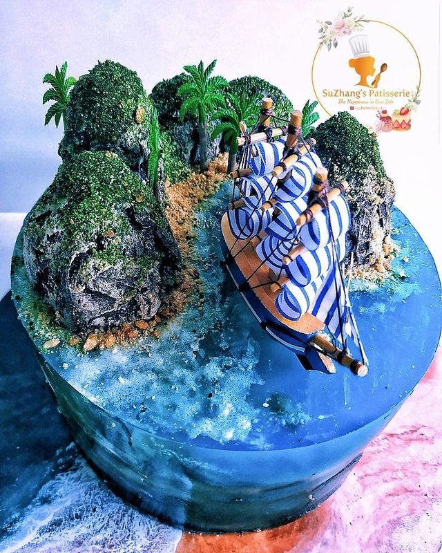Creative marine and ocean theme cake made with jelly, featuring a cute sailing boat prop.
